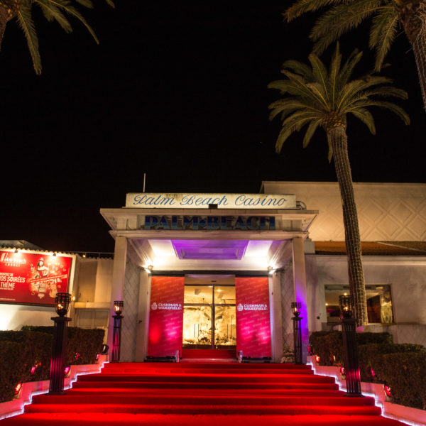Venue entrance for gala dinner moulin rouge theme party in Cannes