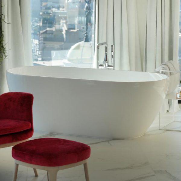 Bathtub in luxurious marble bathroom