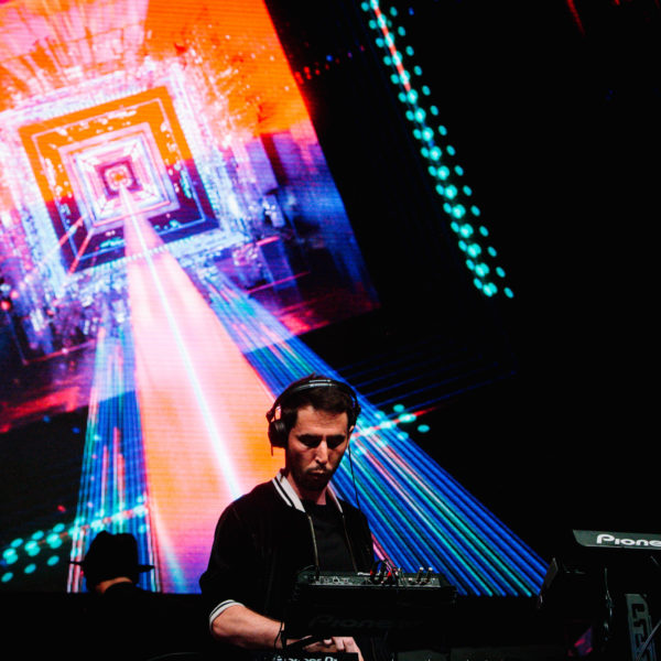 vjing during a summer festival on a giant led screen on stage
