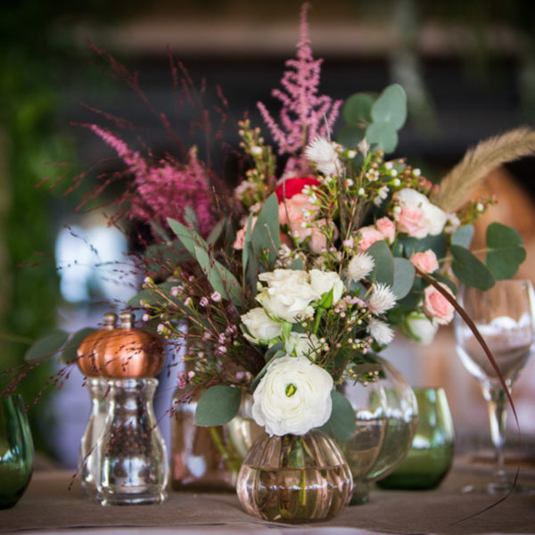 bucolic design with floral center pieces during MAPIC on the beach