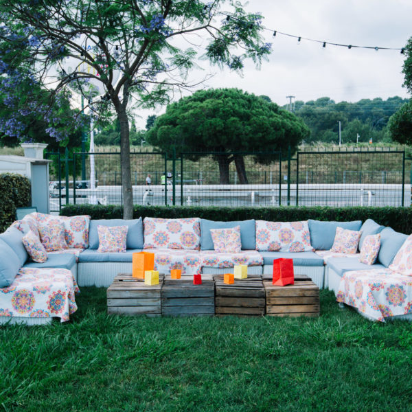 Sofas with floral fabric on top for a hippie chic look and wooden crates low tables
