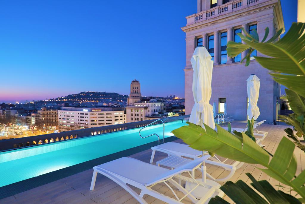 Rooftop swimming pool at night Paseo de gracia
