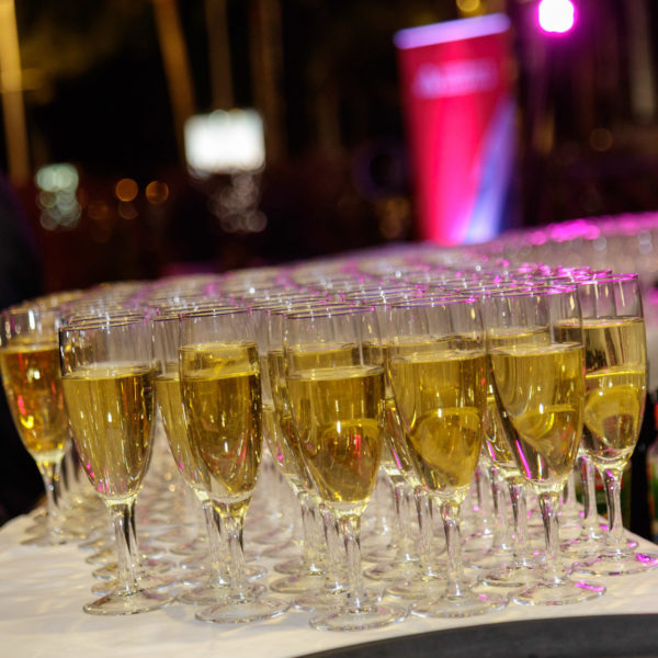 Glasses of champagne on plate to serve to guests during100 years anniversary