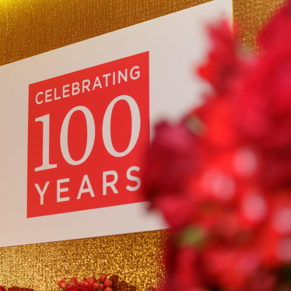 Focus on the 100 years banner on the photocall