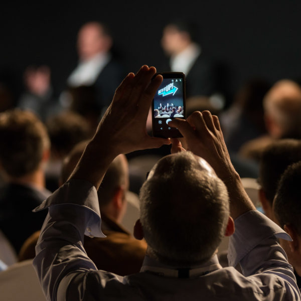 Attendee taking a picture during sales kick off