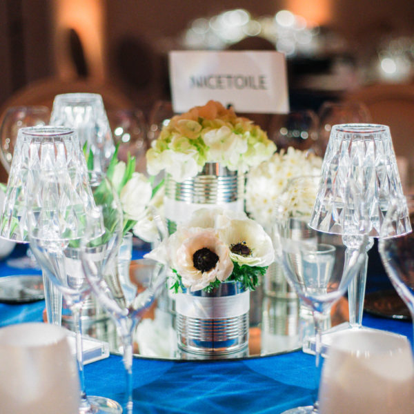 Blue and silver tableware with center pieces during and exclusive dinner during MIPIM