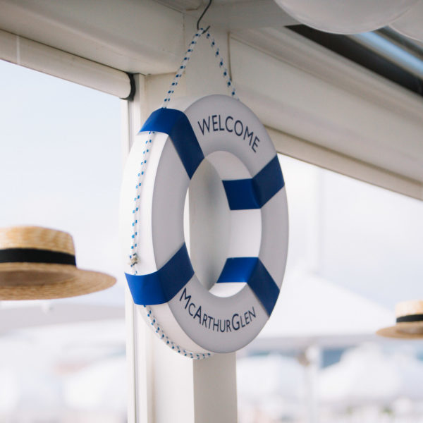 Branded rubber ring and suspended hats decoration under the beach pergola during MAPIC