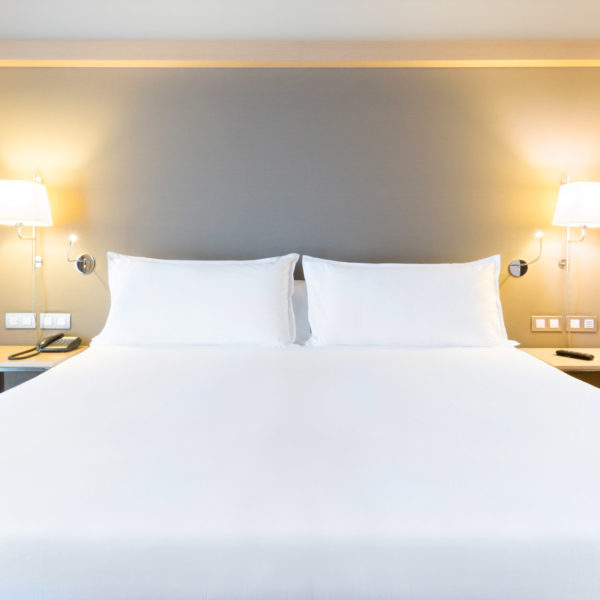 Close view bed in jazzy hotel MWC city center