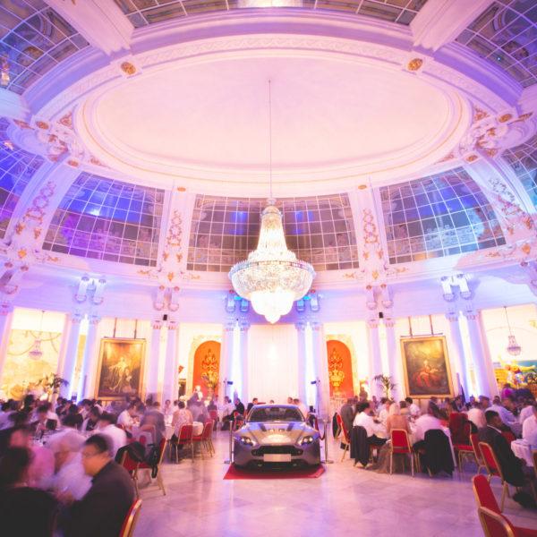 Le Negresco venue with Aston Martin in the center casino royal them party