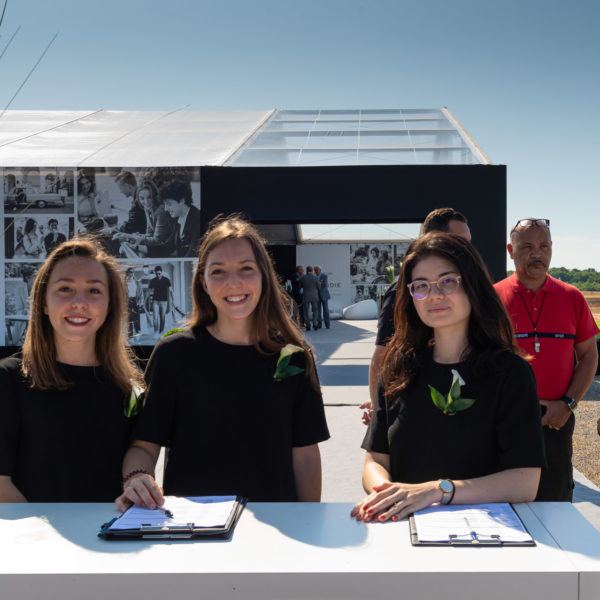 Hostesses in front of the tent to welcome the guests for the ground breaking ground