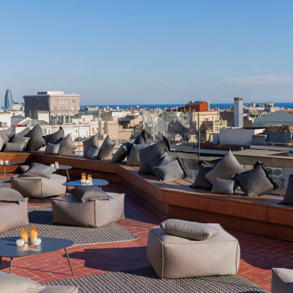 Lounge set-up on the rooftop terrace facing the sea in barcelona