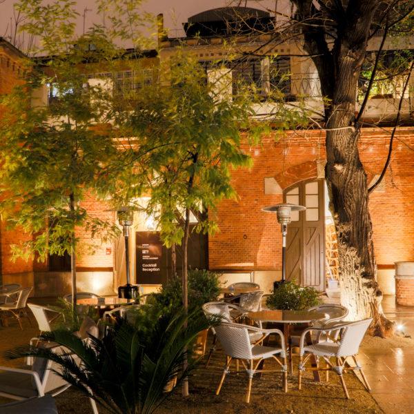 Hidden garden in a secret venue in Barcelona at night