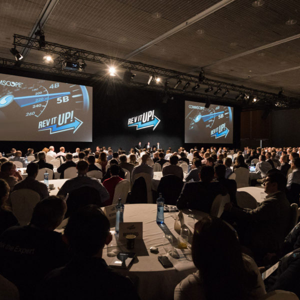 Filled room with audience sales kick off ceremony