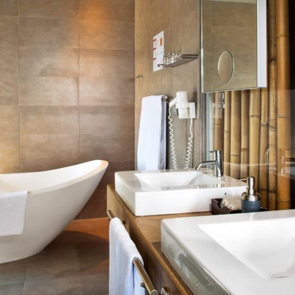 Bathroom with tub and bamboo decoration