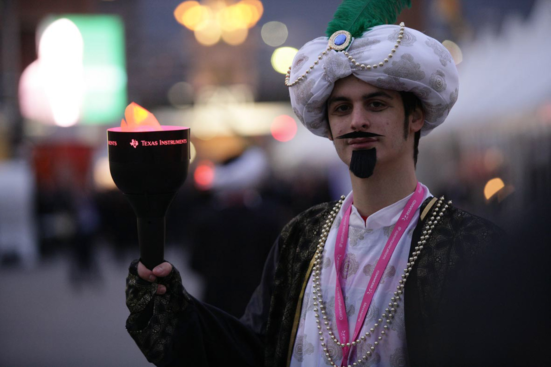 maharaja dressed up actor with branded torch to lead the way towards the venue at the exit of MWC congress in Barcelona