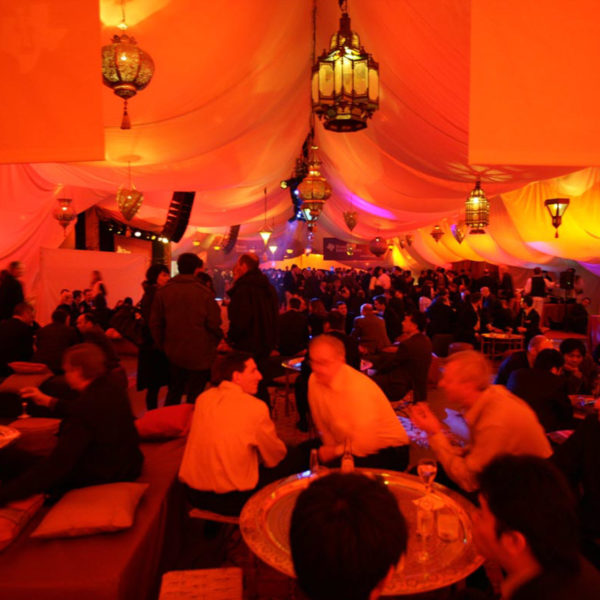 orange warm colours reflected on the tent in the netwokring lounge during the theme party in Barcelona MWC One Thousand and One Nights theme party
